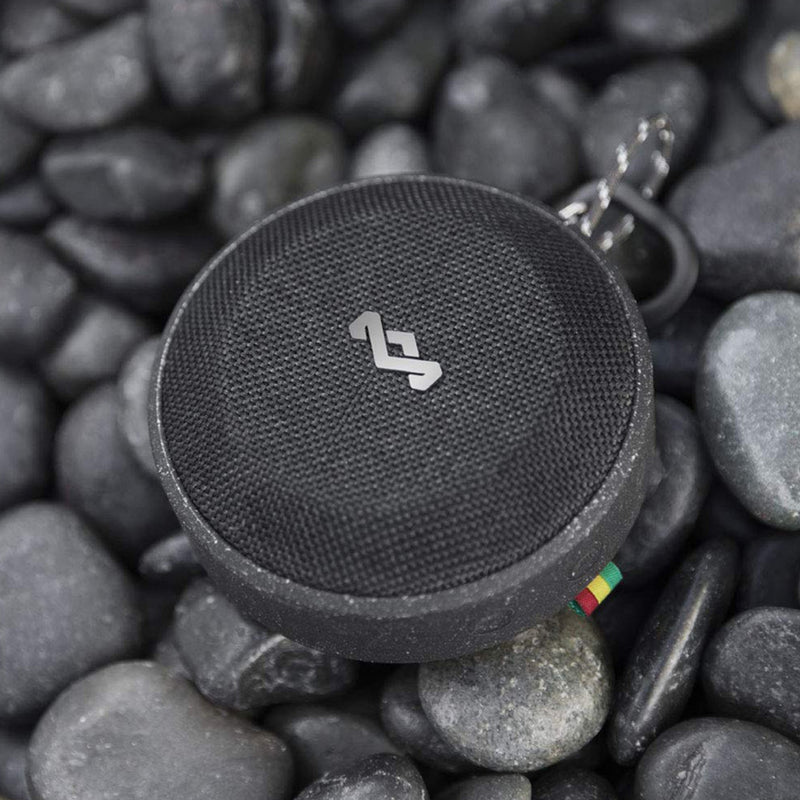Waterproof Floating Speaker lifestyle on black rocks