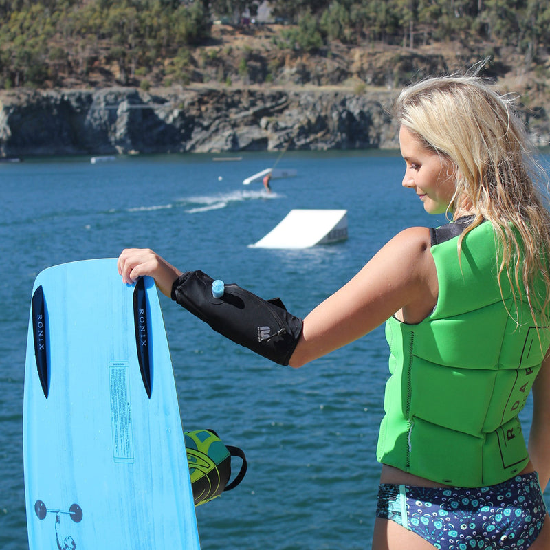 wearable water container lifestyle woman on surf board