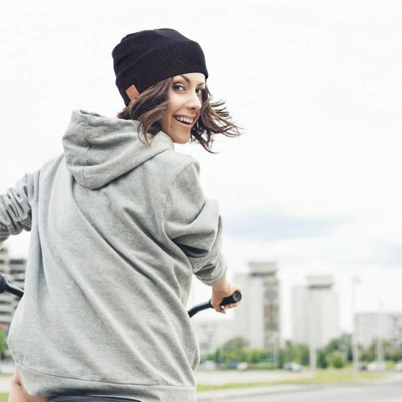 wireless smart beanie lifestyle girl on bike