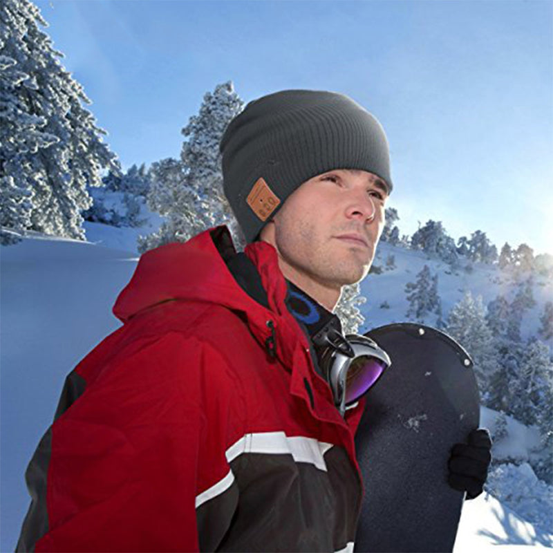 wireless smart beanie lifestyle man snowboarding