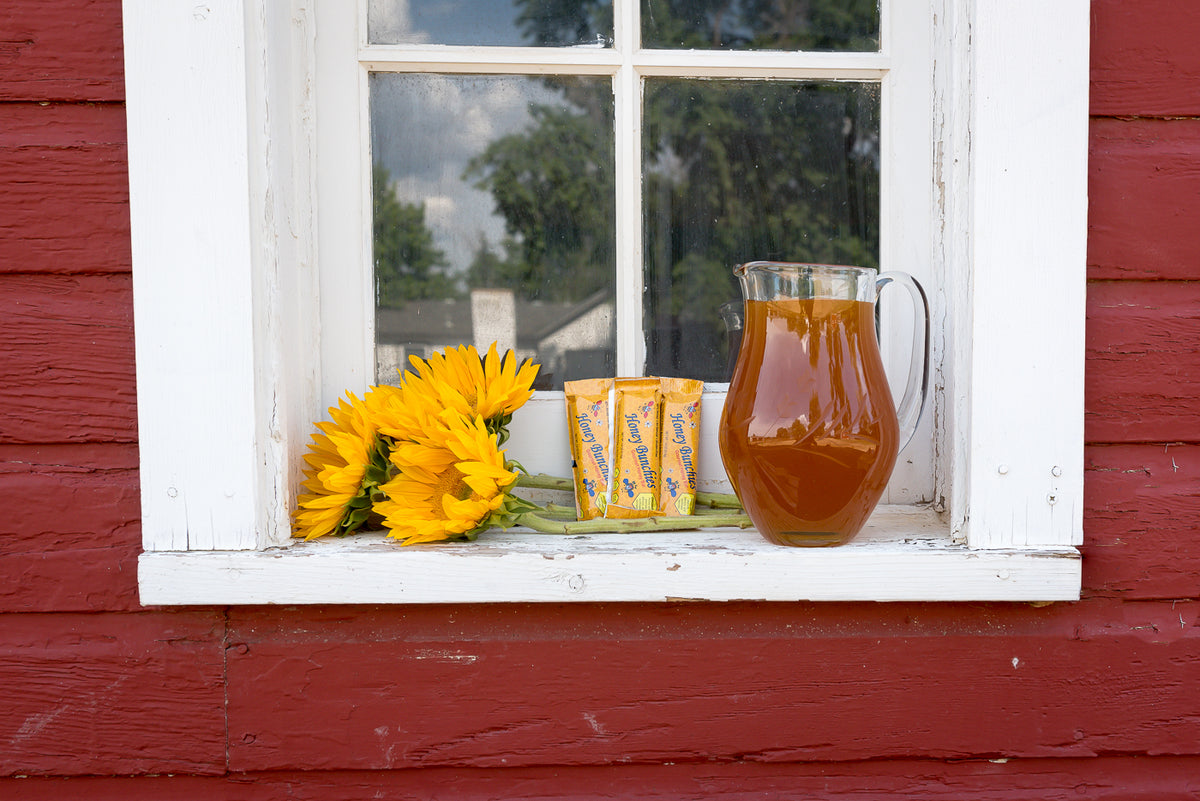 Honey Bunchies, sunflowers, pitcher of honey, farm