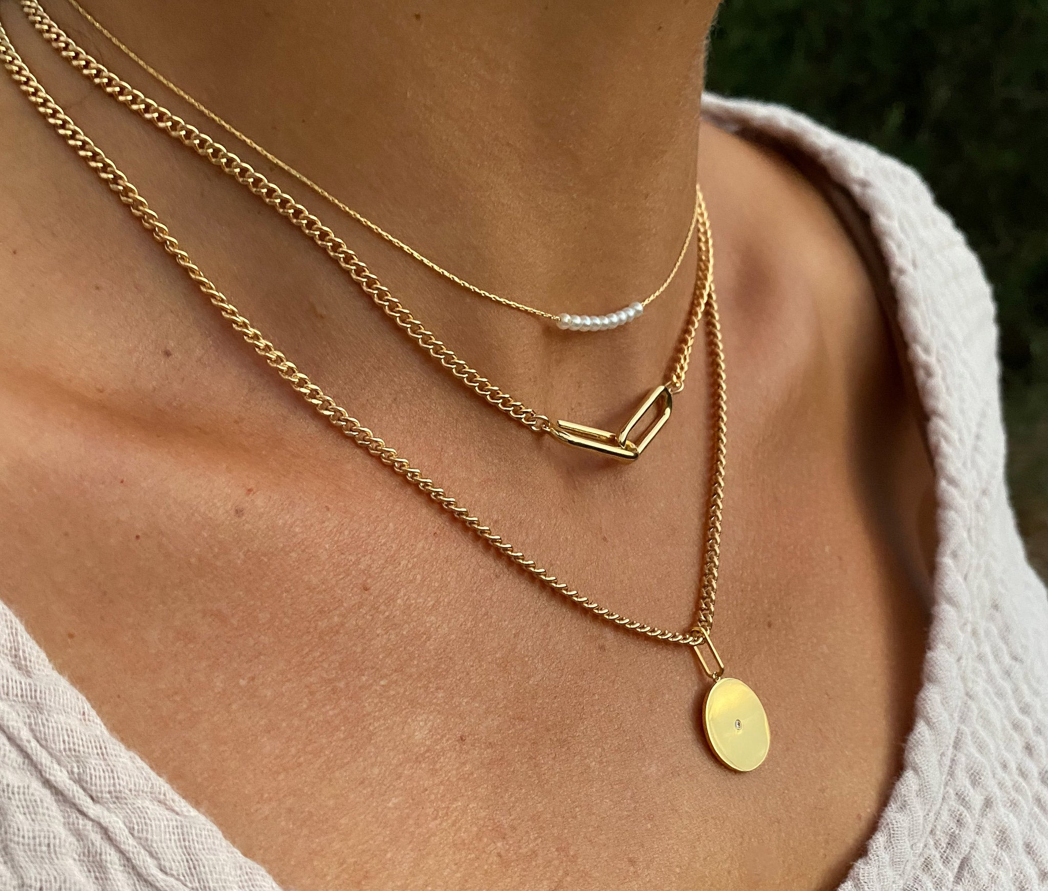 layered necklaces, women's jewelry, women's accessories, made in California, handmade, made by hand, 14k gold, mix and match, everyday wear, opal, alchemy, zodiac, symbols, talisman, engrave, customized, made by women for women, made with love