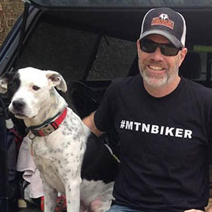 Reddog Apparel owner Mike and his dog Ryder