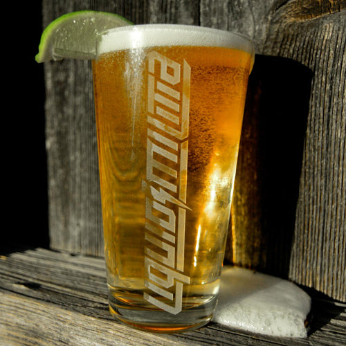 Liquid Militia Pint Glass filled with beer and line wedge