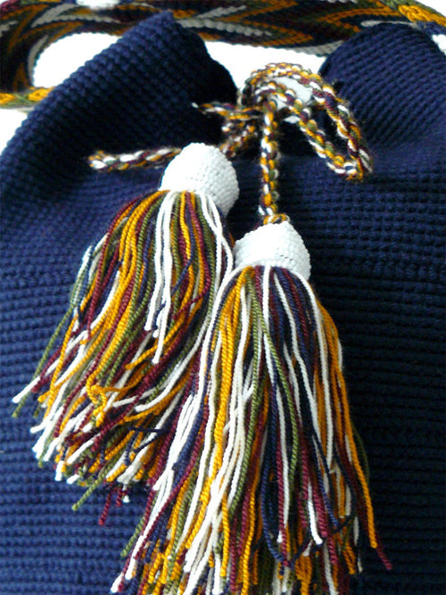 Dark blue and mustard Tassels with white beads of the Dark blue woven shoulder bag Palmazul Beachwear Wayuu Mochila