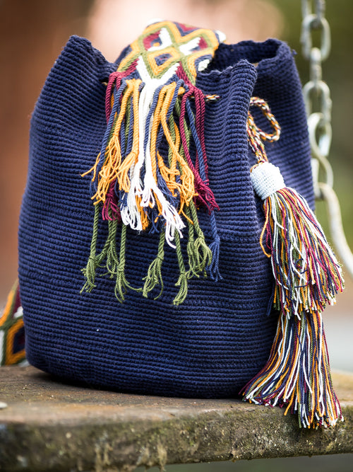 Dark blue and mustard woven shoulder bag with tassels and white beads Palmazul Beachwear Wayuu Mochila