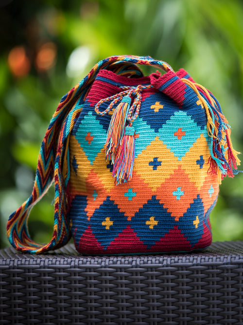 Diamond pattern orange, yellow, red and blue woven shoulder bag with tassels and beads Palmazul Beachwear Lifestyle Wayuu Mochila