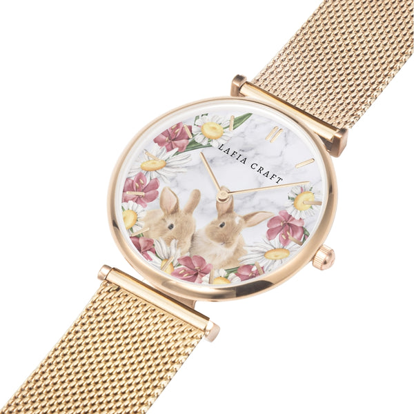vintage rabbit and floral garden pattern Watch designed for women, it comes with rose gold case and rose gold stainless steel mesh strap.