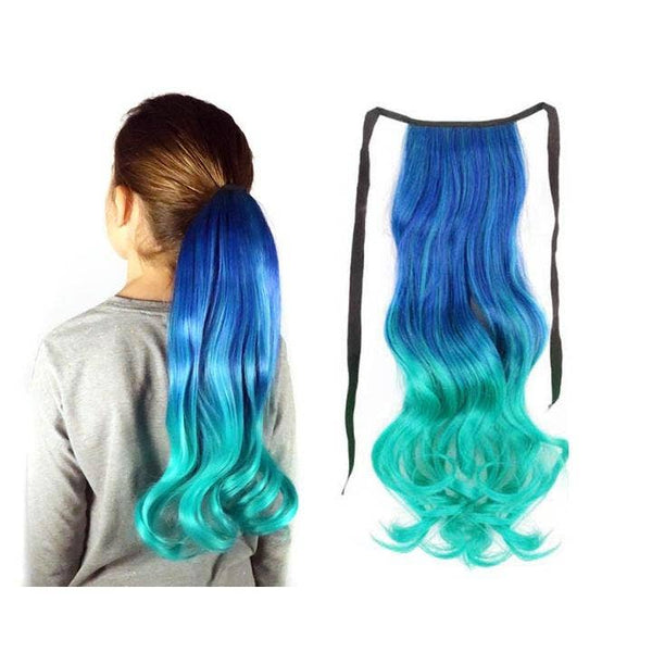 Clip in long ponytail Teal at the top with ombre effect to an Aqua blue at the bottom. Ponytail on the right, worn by a girl on the left.