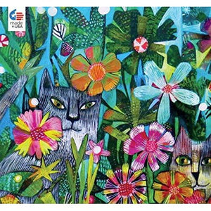 Image depicts two cats hidden in a colorful garden of abstract flowers