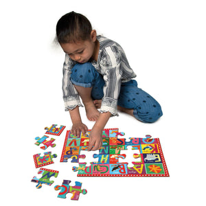 Child assembling the large-pieced floor puzzle