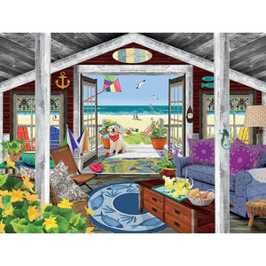 Puzzle image depicts a beach cottage looking out on a deck with flowers and a golden retriever and the shore in the distance.