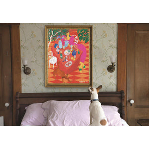 Framed puzzle mounted over a bed with pink sheets and a jack russel sitting on the bed looking at the photo
