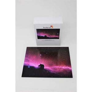 Completed puzzle depicting a dramatic fuchsia light, and cloud against a dark starry sky