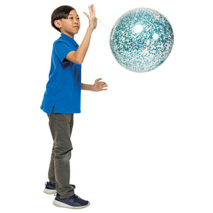 Child in a blue shirt playing with clear punch balloon