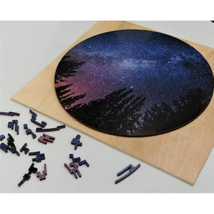 Assembled puzzle on a piece of wood, with extra pieces off to the side.
