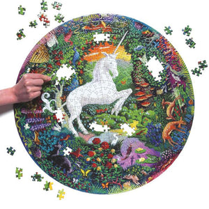 Puzzle in the process of being assembled, with a white unicorn rearing up in the center of a colorful garden with animals