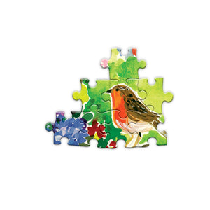Detail of pieces from seagull garden puzzle, A robin on a green background