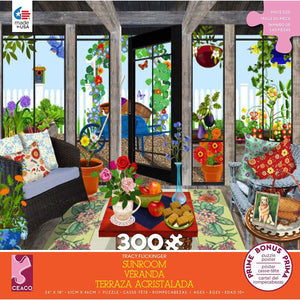 Box for puzzle by artist, Tracy Flickinger, depicts a lovely sunroom that opens up to a garden full of flowers.