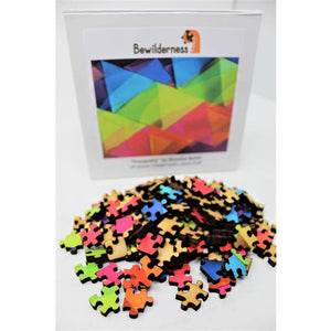 Box with wooden puzzle pieces