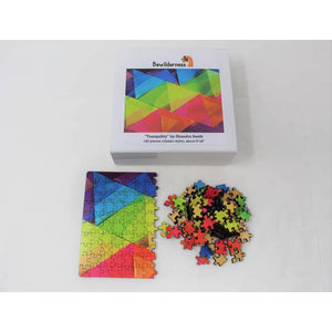 Box with half-assembled puzzle in lower left and puzzle pieces on the lower right.