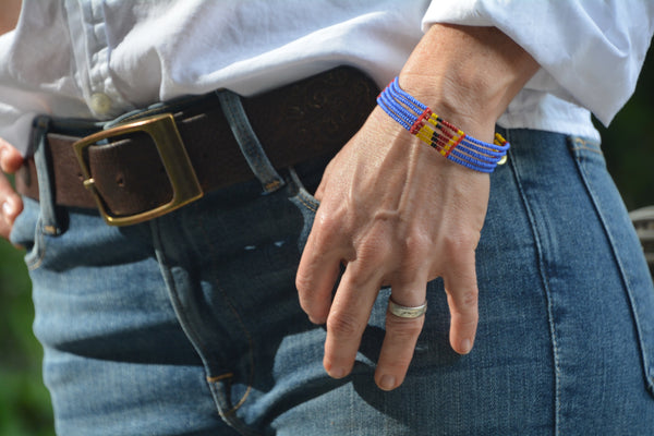 Indigo blue Masai bracelet with red, yellow and black pattern