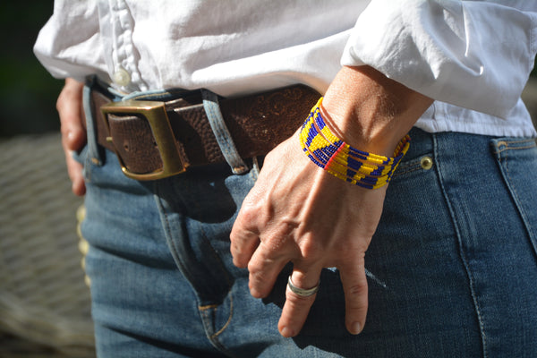 Masai bracelet with bright yellow and indigo triangular pattern