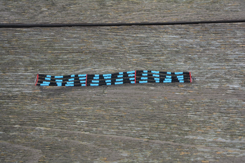Masai bracelet with black and blue triangular pattern