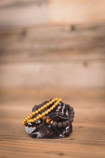 Black Lava Bracelet + Tigers Eye (w/ Gold Bead)
