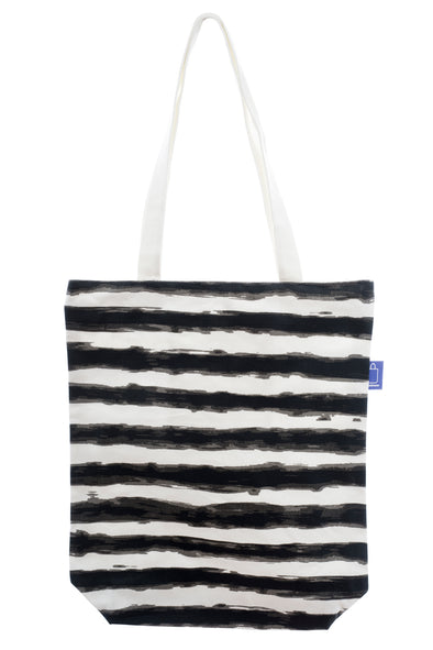 A shopping bag with a black and white design printed on strong cotton fabric. It has a zip for full closure of the bag, and a small inside pocket. Large enough to hold an ipad, laptop or some groceries etc. Perfect to use instead of a plastic bag.