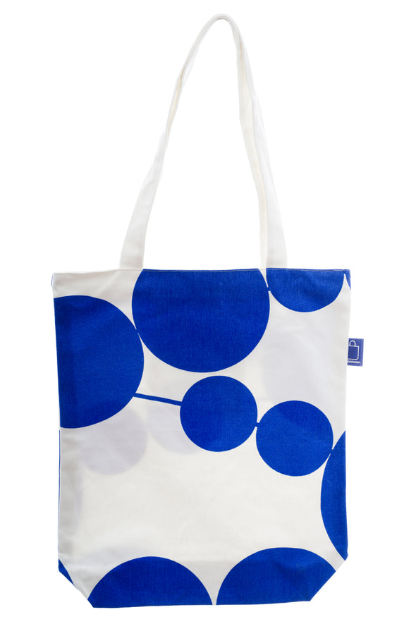 A cotton bag in a blue and white design, perfect to bring to the beach. It has a zip for full closure of the bag, and a small inside pocket. Large enough to hold an ipad, laptop or some groceries.