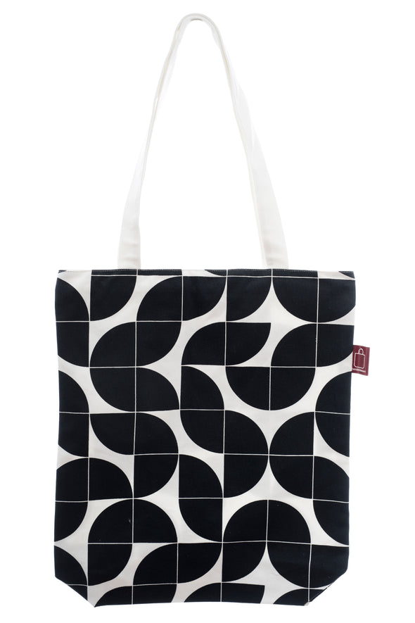 A black and white cotton shopping bag with a zip for closure and a small inside pocket. Large enough for some groceries or an ipad.