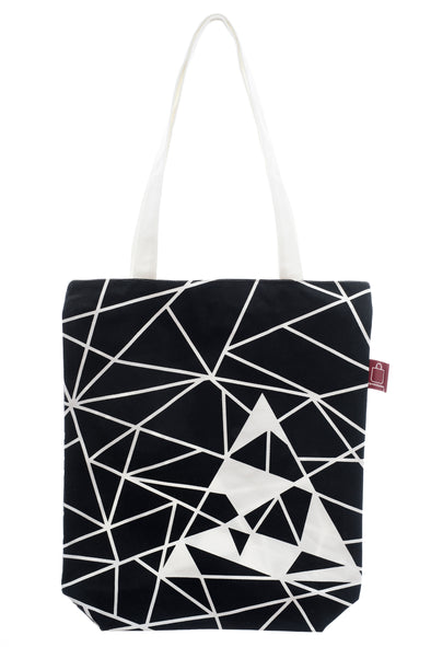 A black and white cotton bag with a zip for closure and a small inside pocket. Large enough for some groceries or an ipad.