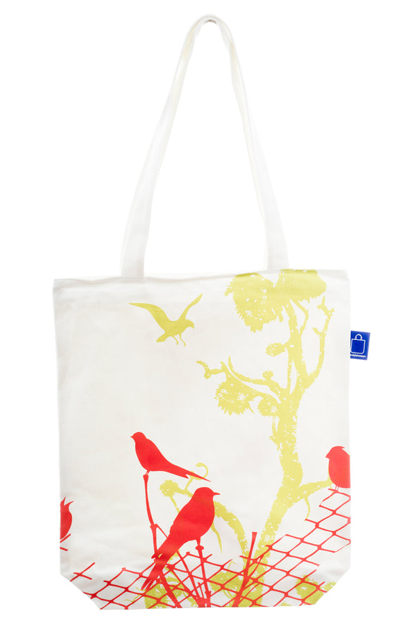 A cotton bag with birds design. It has a zip for full closure of the bag, and a small inside pocket. Large enough to hold an ipad, laptop or some groceries.