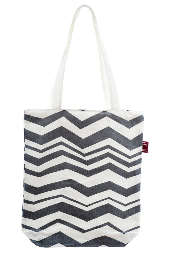 A bag with design printed on strong cotton fabric. It has a zip for closure and a small inside pocket. Large enough to hold an ipad, laptop or some groceries.