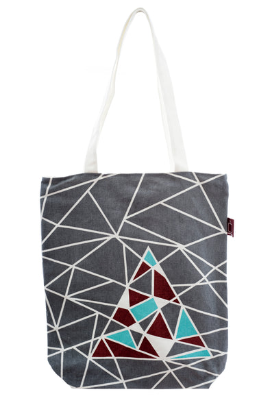 A versatile tote with design printed on strong cotton fabric. It has a zip for closure and a small inside pocket. Large enough to hold an ipad, laptop or some groceries.