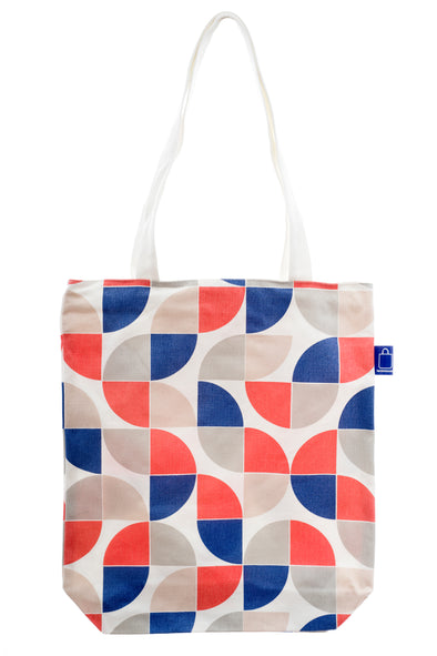 A versatile cotton tote with a nice design. It has a zip for closure and a small inside pocket. Large enough to hold an ipad, laptop or some groceries.