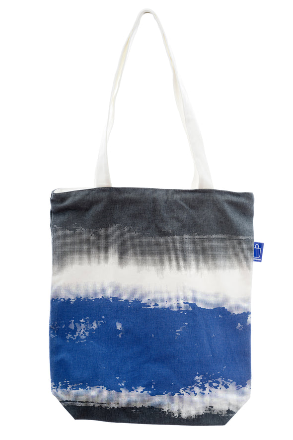 A versatile shopping tote with a nice design. It has a zip for closure and a small inside pocket. Large enough to hold an ipad, laptop or some groceries.