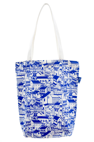 A versatile tote in cotton with a design. It has a zip for closure and a small inside pocket. Large enough to hold an ipad, laptop or some groceries.