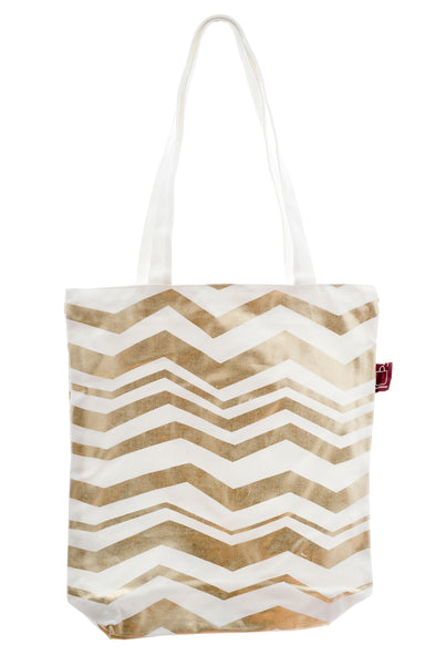 A versatile white and gold tote in cotton. It has a zip for closure and a small inside pocket. Large enough to hold an ipad, laptop or some groceries.