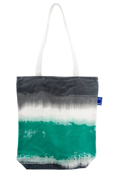 A versatile cotton tote. It has a zip for closure and a small inside pocket. Large enough to hold an ipad, laptop or some groceries.