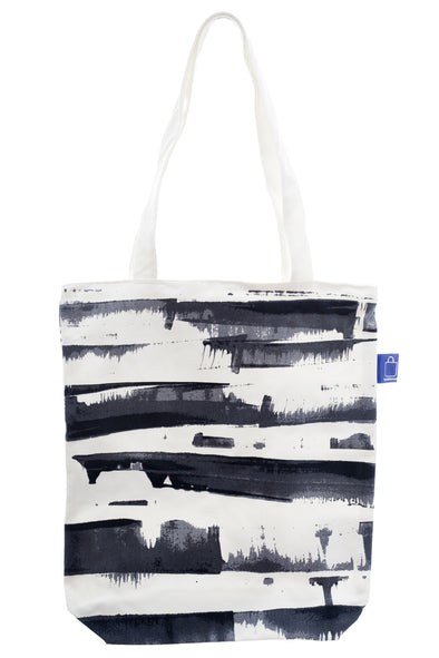 A cotton tote with a zip for closure and a small inside pocket. Large enough to hold an ipad, laptop or some groceries. Perfect for the beach and to use instead of a plastic bag.