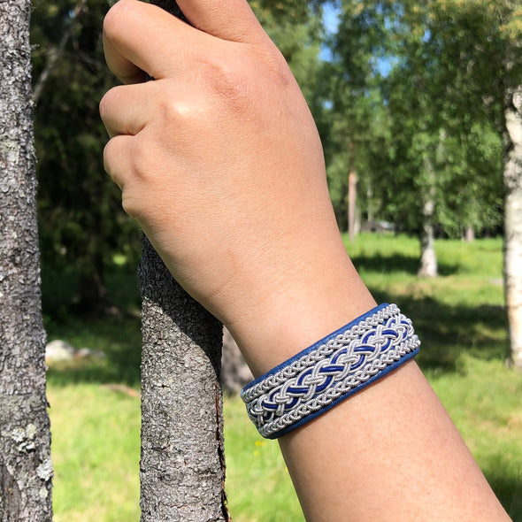 Gry sami bracelet by julevu. handmade in Lapland. Blue reindeer leather silver embroidery Scandinavian design