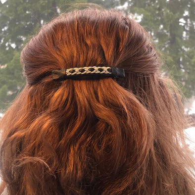 A nice hair clip with pewter emboridery on black reindeer leather, made by Julevu Sweden in Swedish Lapland.