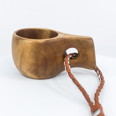 A 4 cl kuksa cup made from birch tree. Perfect for a small espresso coffee or snaps. After use, just clean it with water and you can use it again and again. Made in Swedish Lapland. Perfect as a gift to a person who likes the Outdoors. Buy at Julevu.com