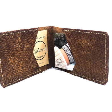 An exclusive small wallet that fits your cards or business cards made in naturally hand tanned salmon skin.