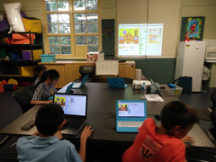 Kids are coding games and animations in Scratch programming environment at Sydney coding school RUNSTEM in Ryde