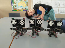 A boy and cool robots projects from RUNSTEM robotics school