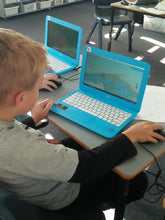A boy is coding 3D game at RUNSTEM programming school