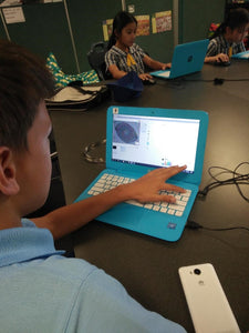 A boy is coding mathematical animation in Scratch visual coding environment
